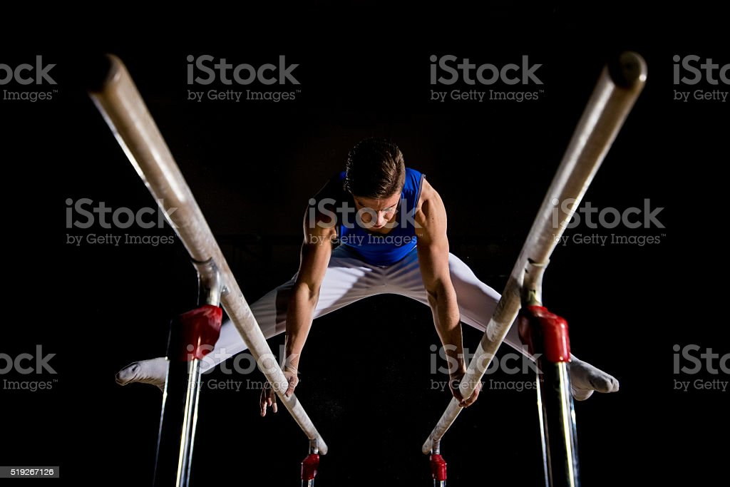 Male gymnast in sports hall stock photo