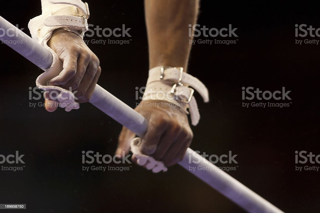 Male Gymnast's hands on high bar stock photo