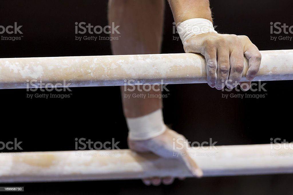 Male Gymnast's hands on parallel bars stock photo