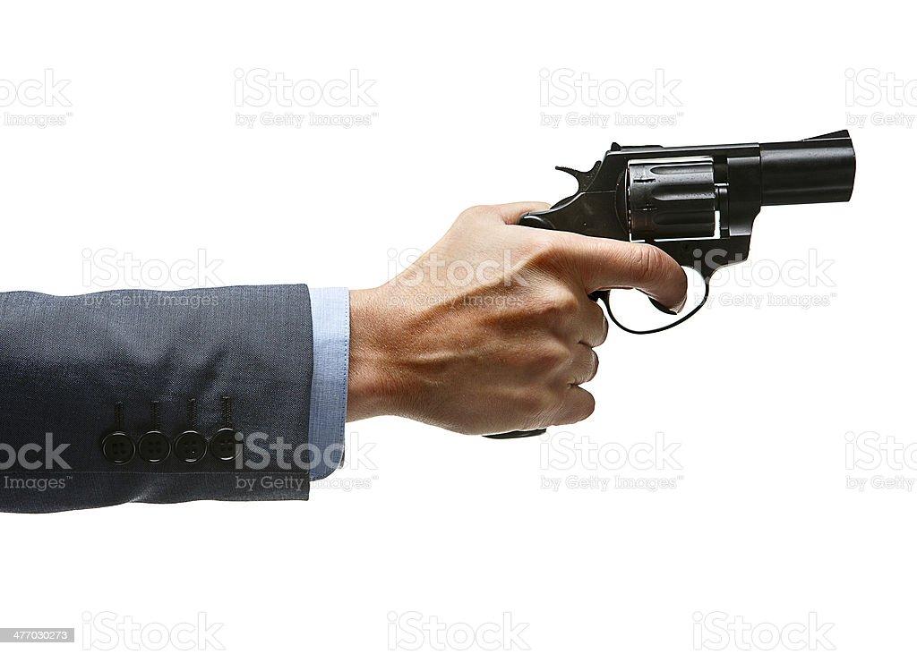Male hand aiming revolver gun stock photo