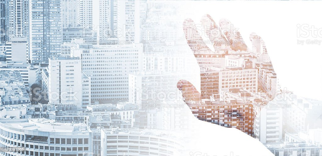 Male hand and modern big city background stock photo