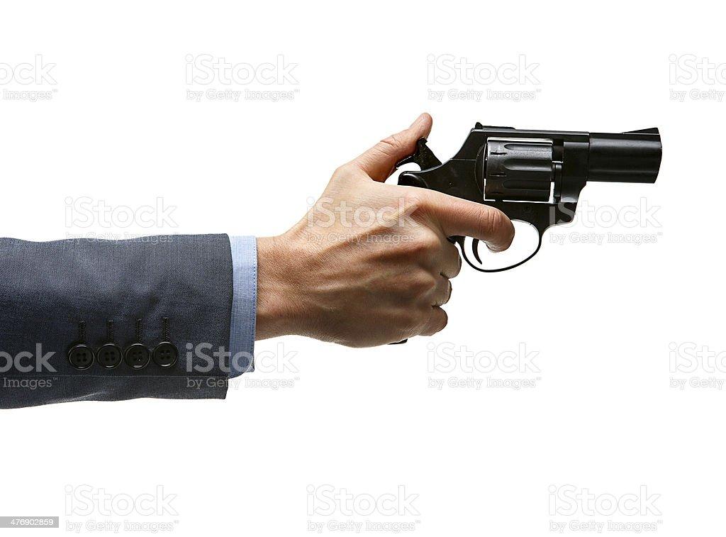 Male hand cocking revolver gun stock photo