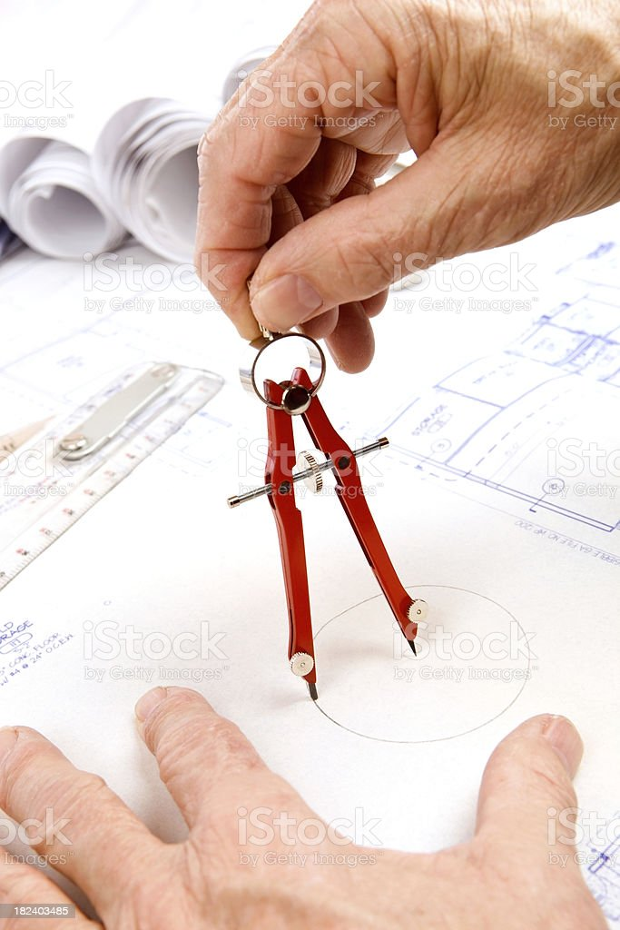Male Hand Drawing Circle on Commercial Blueprint with Compass royalty-free stock photo