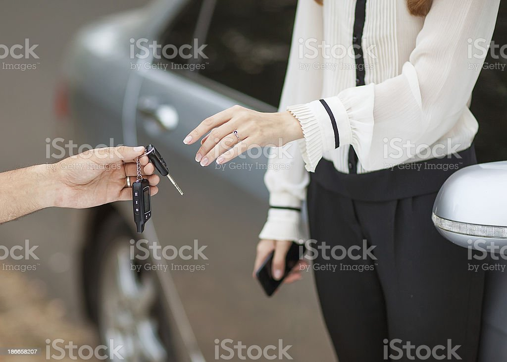 Male hand giving car key to female hand. royalty-free stock photo