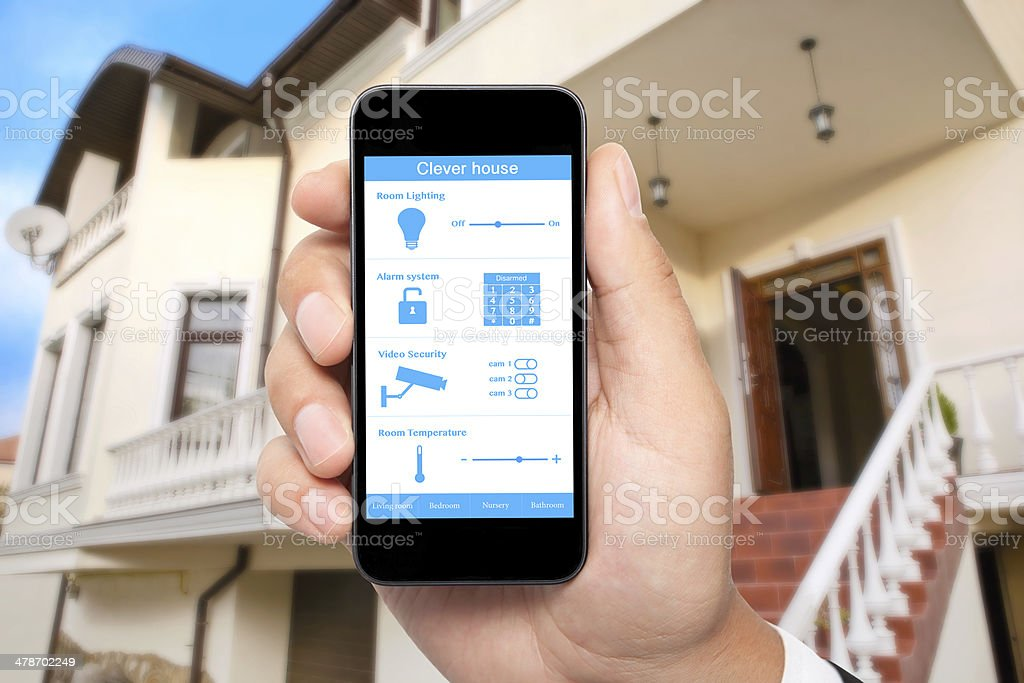 male hand hold phone with system clever house the backgroun stock photo