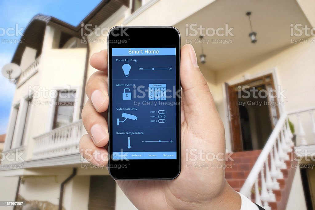male hand hold phone with system smart house stock photo