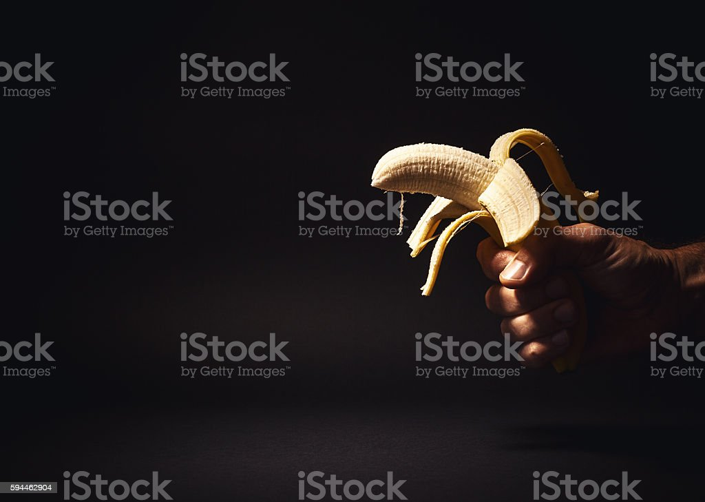 Male Hand Holding a Banana stock photo