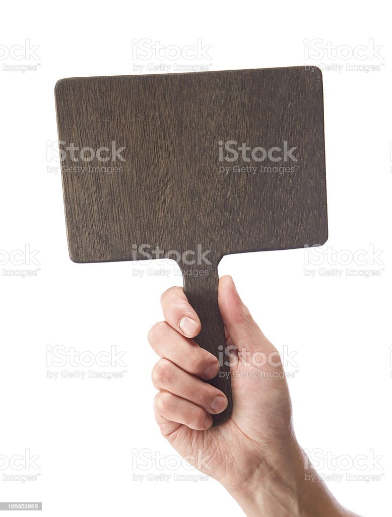 Male Hand Holding a Blank Wood Auction Paddle stock photo