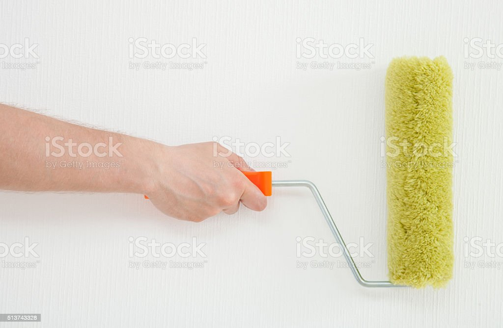 Male hand holding a roller stock photo