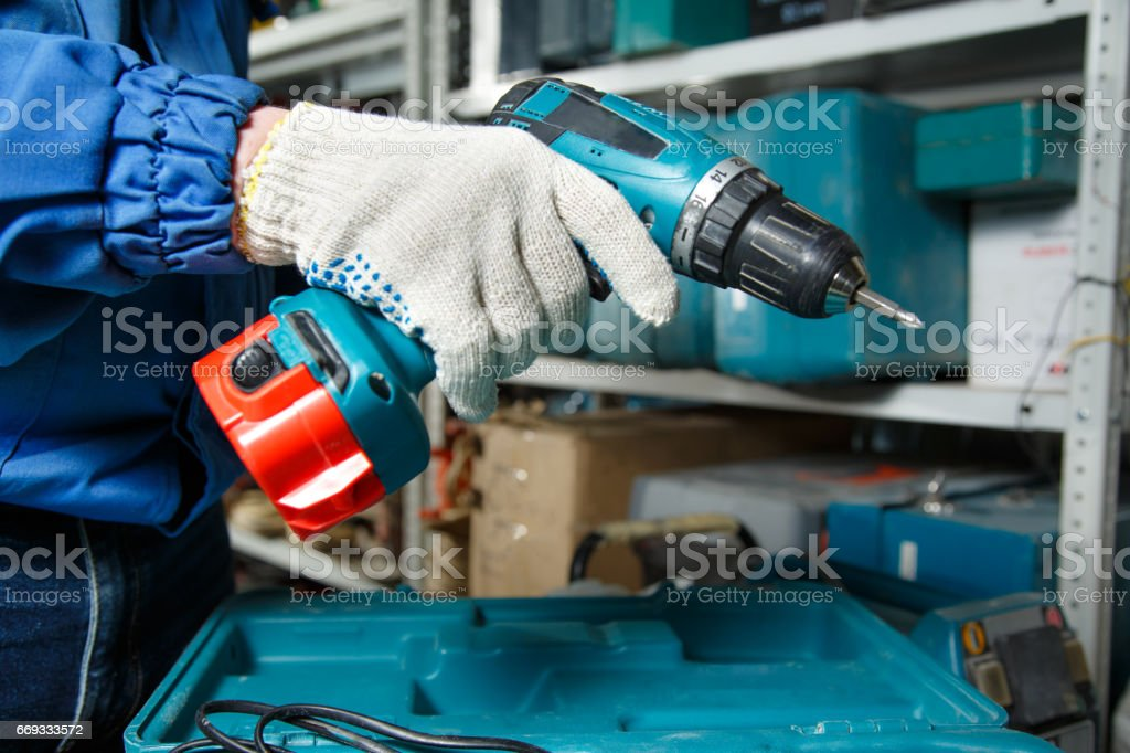 Male hand holding a screwdriver stock photo