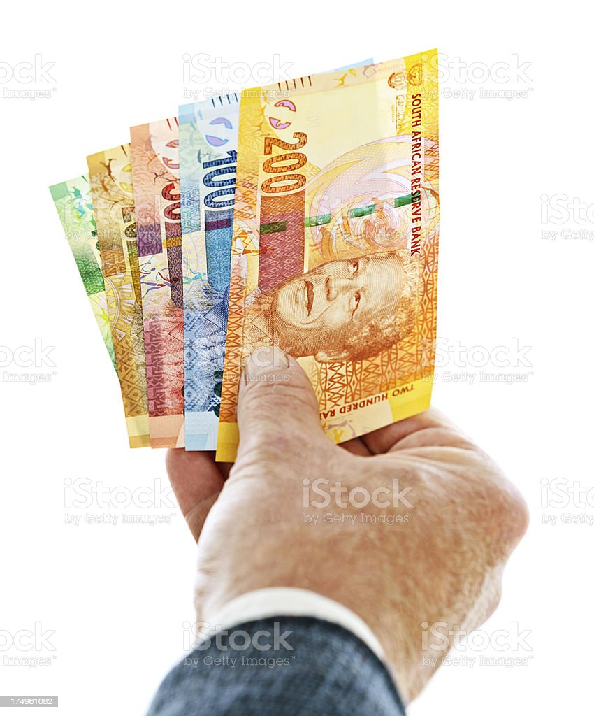Male hand holding a set of new South African banknotes stock photo