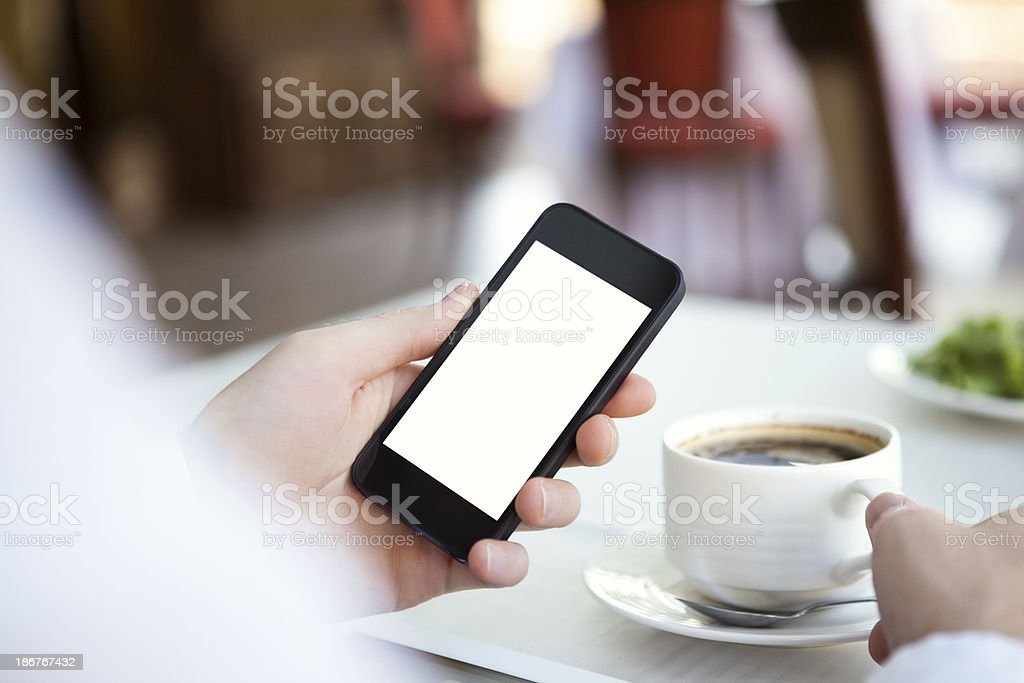 Male hand holding a smart phone with a blank screen royalty-free stock photo