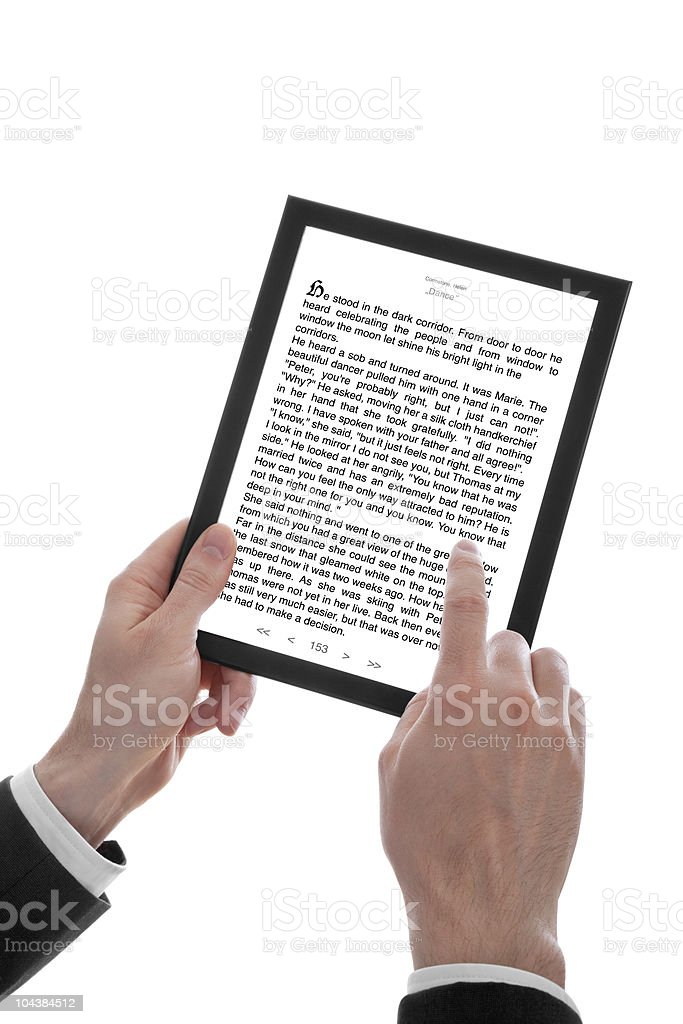 male hand holding a touchpad pc showing an E-Book royalty-free stock photo