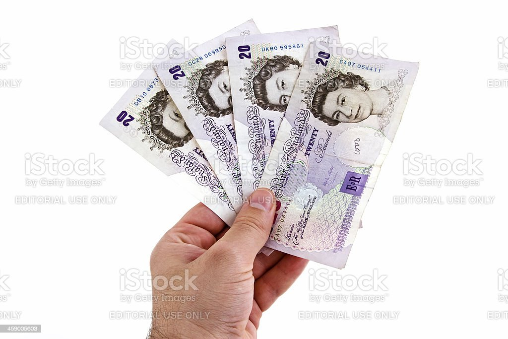 Male hand holding British Pound banknotes, isolated on white stock photo