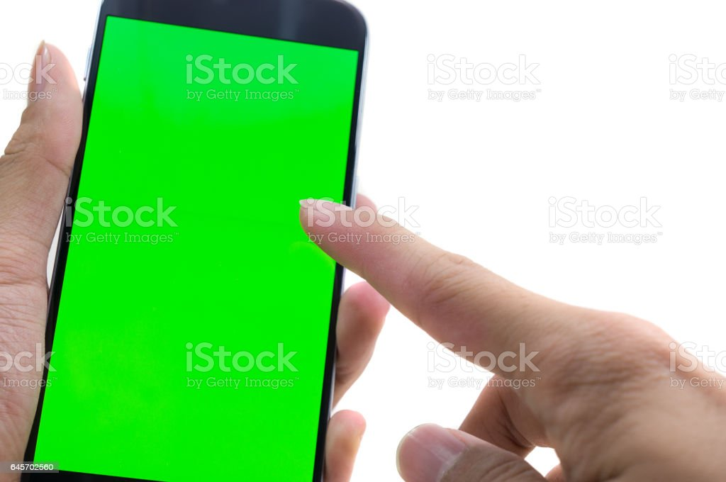 Male hand holding cell phone and typing stock photo