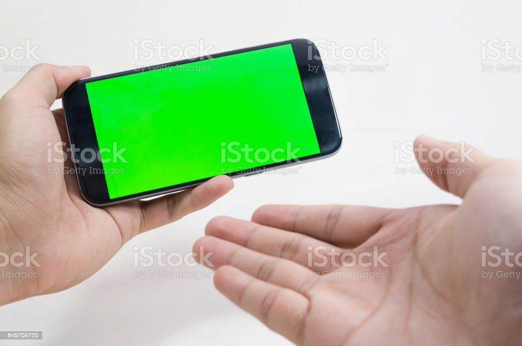 Male hand holding cell phone on white background stock photo