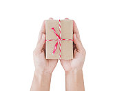 Male hand holding gift box on hand, isolated on white