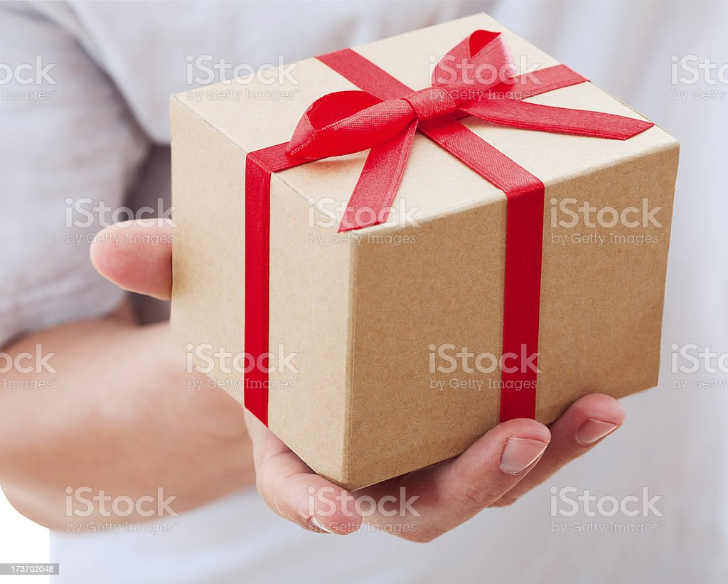 male hand holding gift with ribbon. royalty-free stock photo