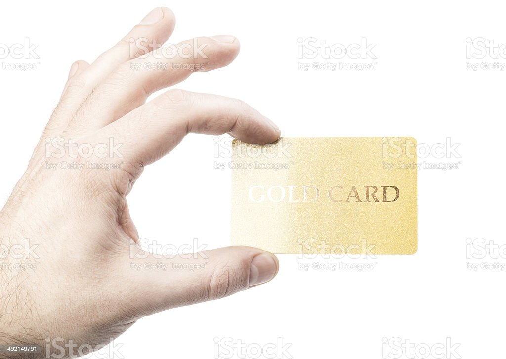 male hand holding gold credit card isolated on white background stock photo
