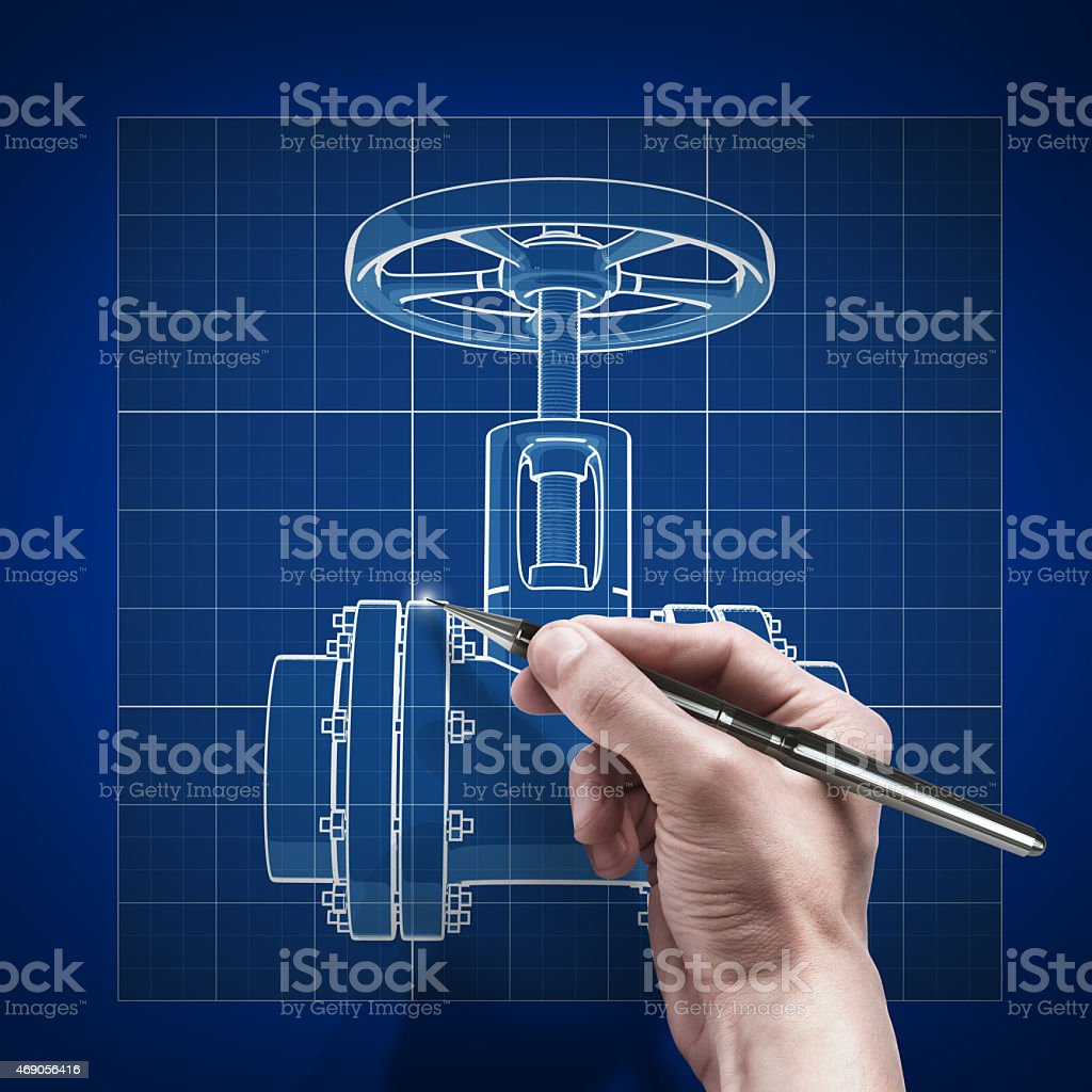 Male hand holding pen tracing digital blueprint on blue wall stock photo