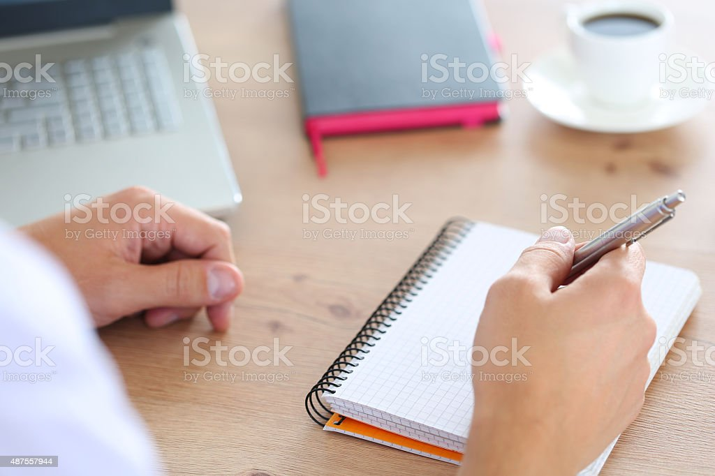 Male hand holding silver pen stock photo