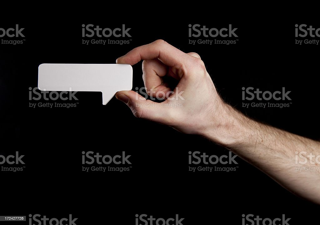 Male hand holding speech bubble royalty-free stock photo