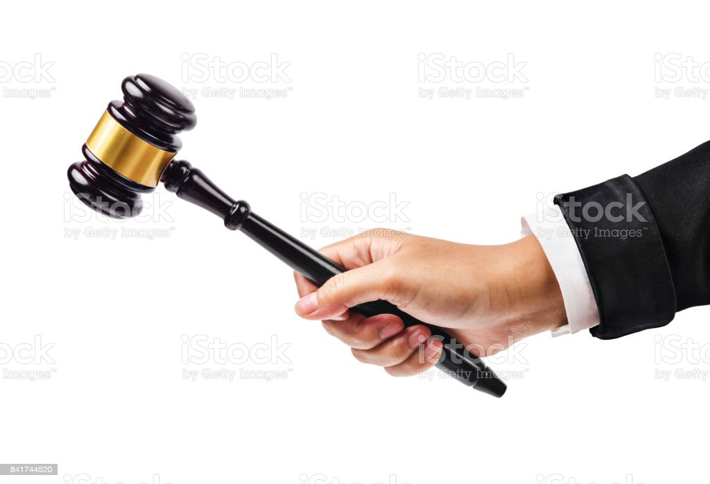 Male hand holding wooden gavel stock photo