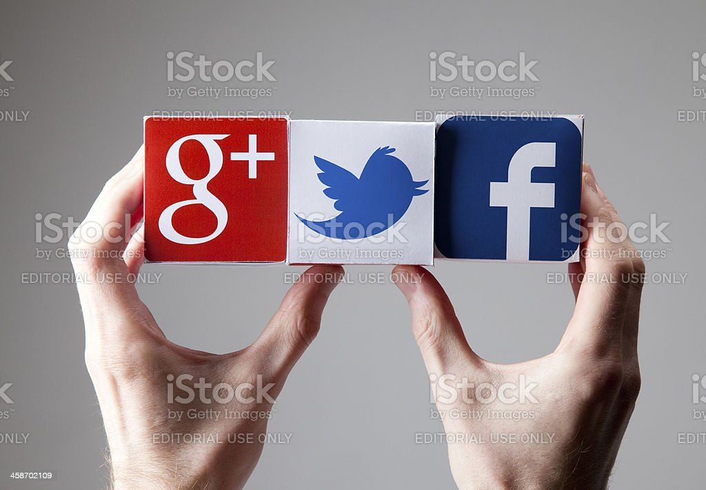 Male hand holds a social network of blocks stock photo