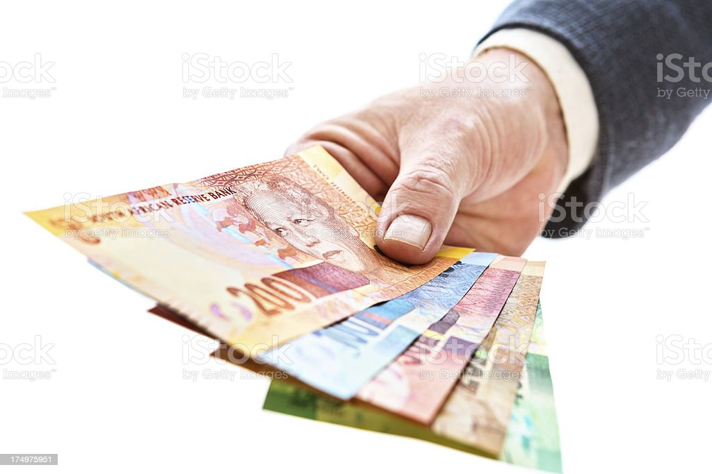 Male hand holds out Mandela banknotes: new South African currency stock photo