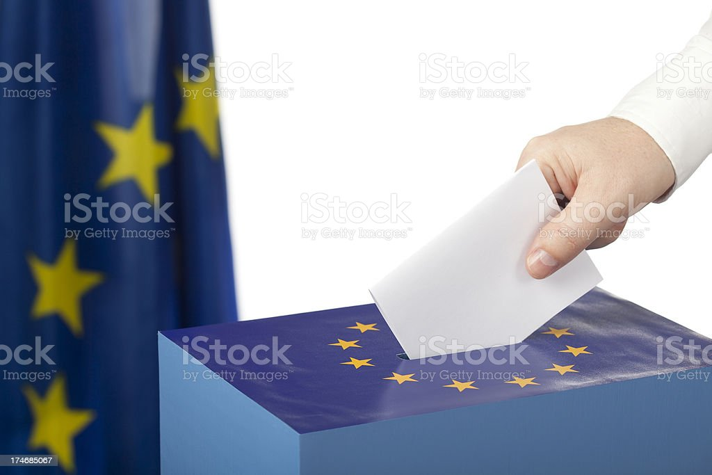 male hand inserting ballot royalty-free stock photo