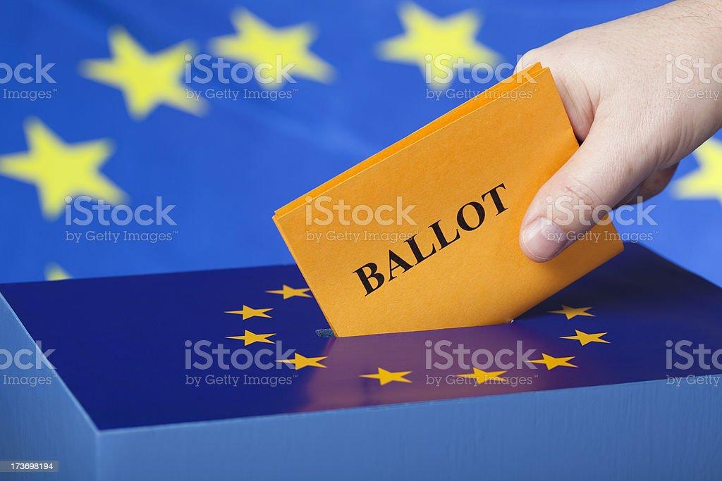 Male hand inserting ballot to EU ballot box stock photo