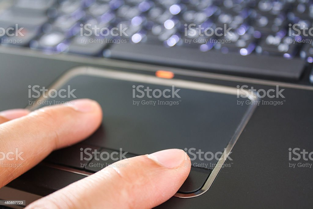 male hand is touching the laptop touchpad royalty-free stock photo