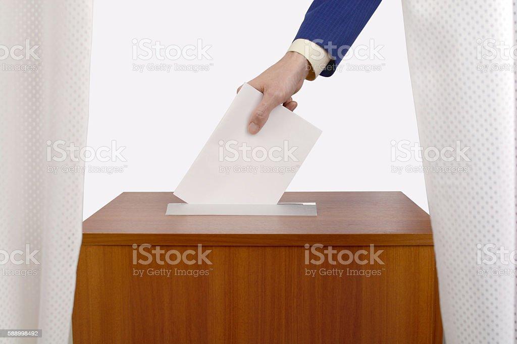 Male hand man casts ballot stock photo