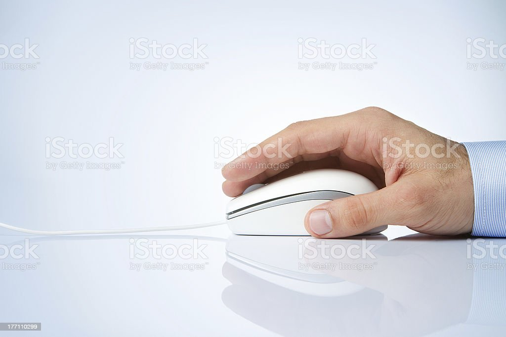 A male hand on a computer mouse on white background stock photo
