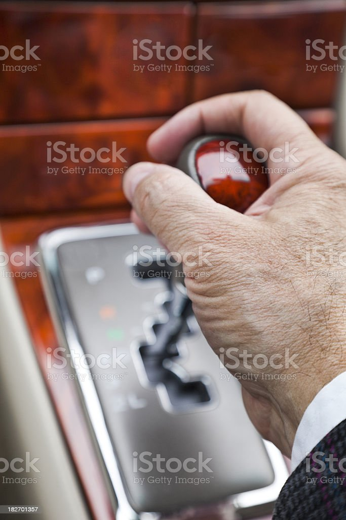 male hand on automatic gearshift lever in luxury car royalty-free stock photo