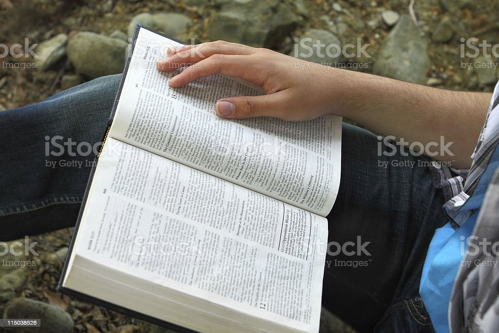 Male hand on Bible royalty-free stock photo