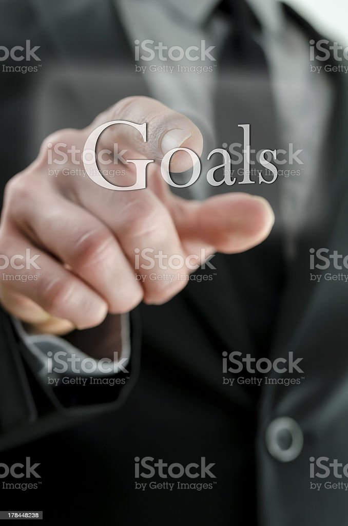 Male hand pointing at Goals icon on  touch screen interface royalty-free stock photo