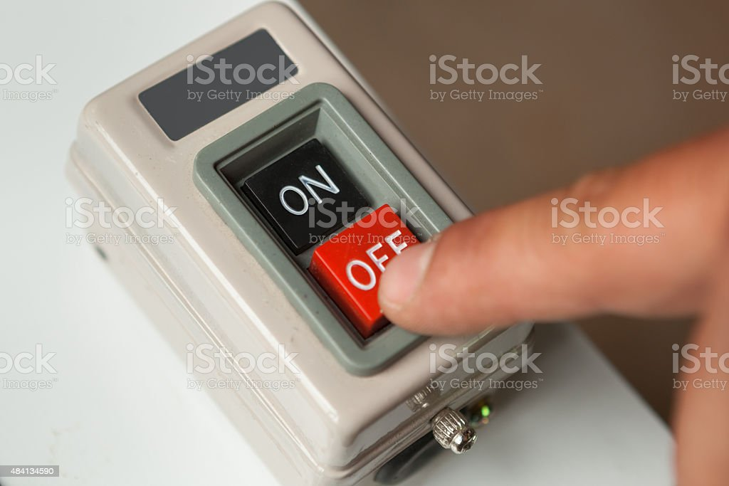 Male hand pushing red off button. stock photo