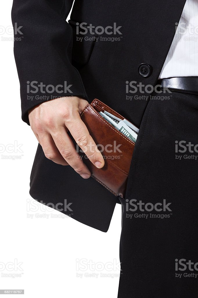 Male hand puts purse into his trouser pocket stock photo