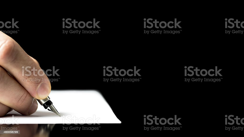 Male hand ready to write with a fountain pen stock photo