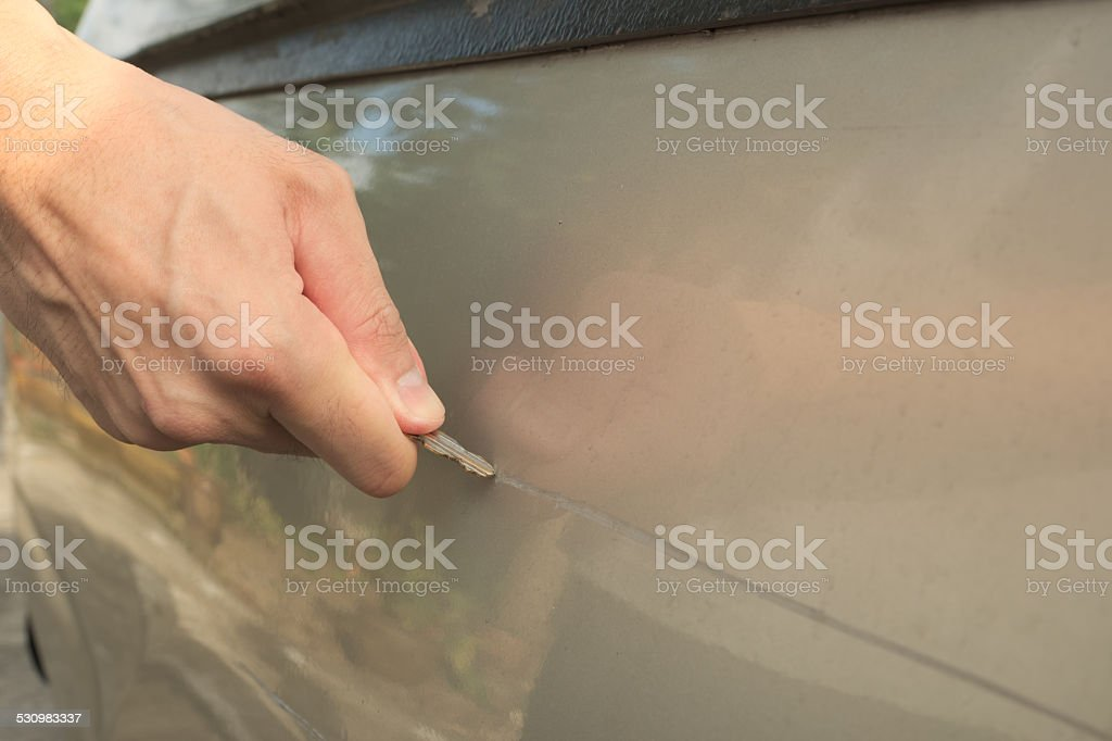 Male hand scratching a car stock photo