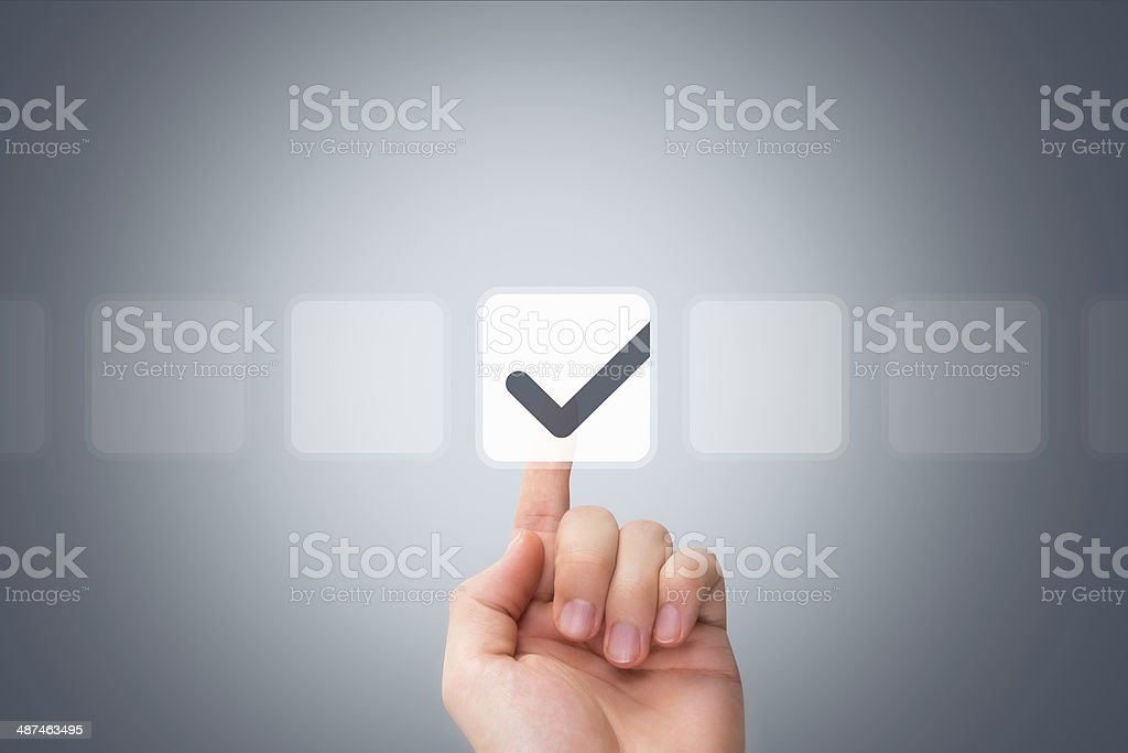 Male Hand Touching Button and Ticking Check Box stock photo
