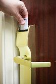 Male Hand Unlocking Electronic Hotel Door Lock with Key Card