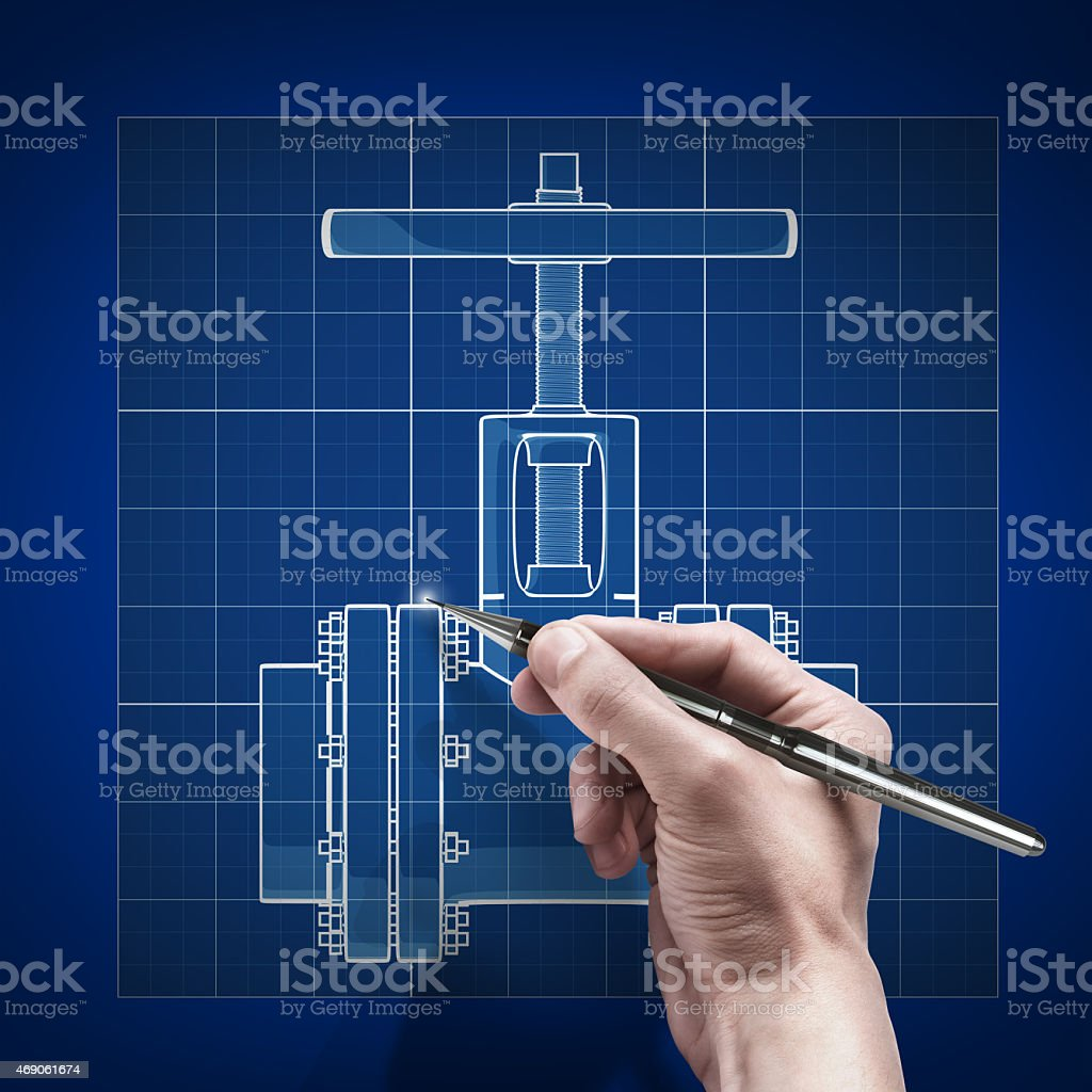 Male hand using a pen to sketch on a blue print stock photo