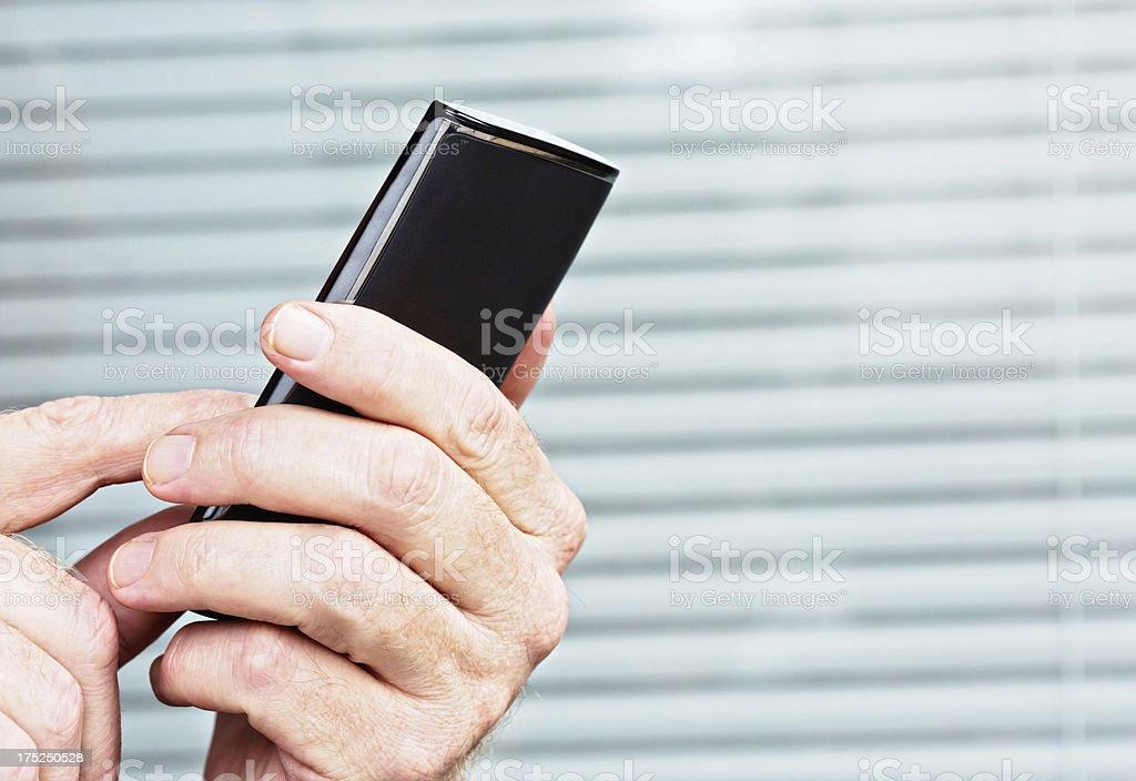 Male hand using smart phone royalty-free stock photo