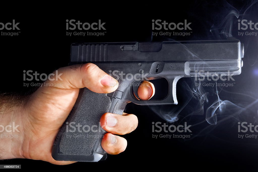 Male hand with a gun stock photo