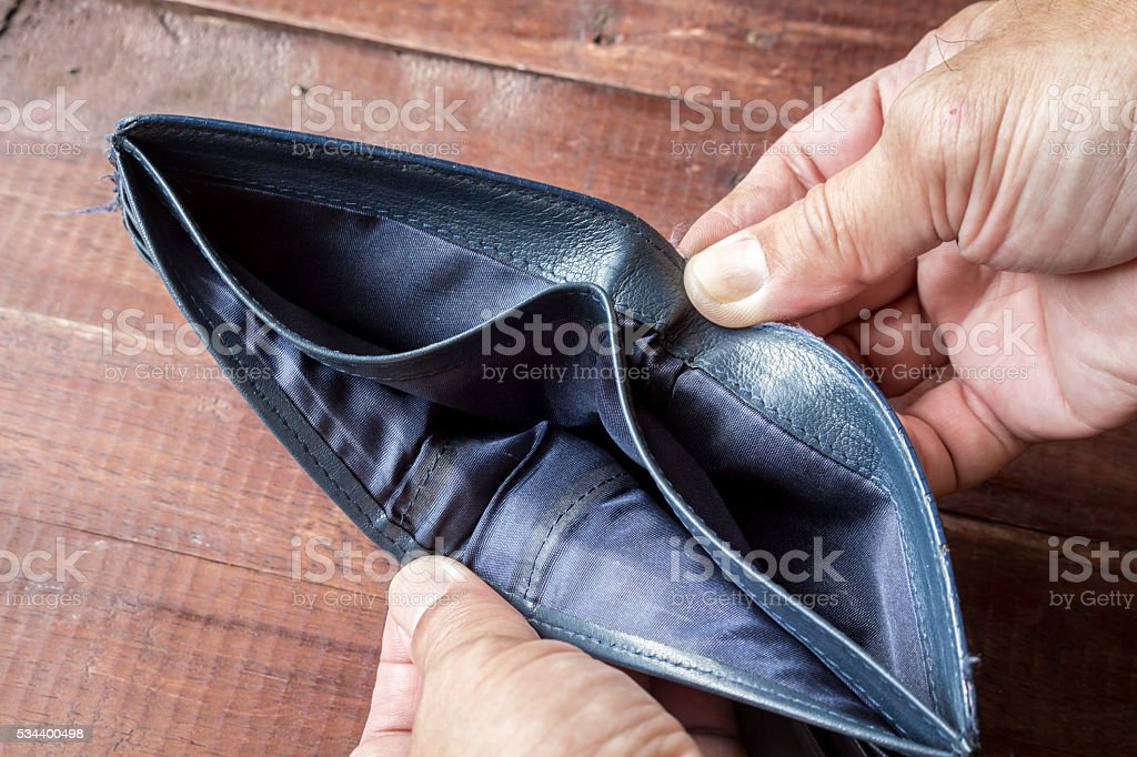 Male hand with an empty wallet stock photo