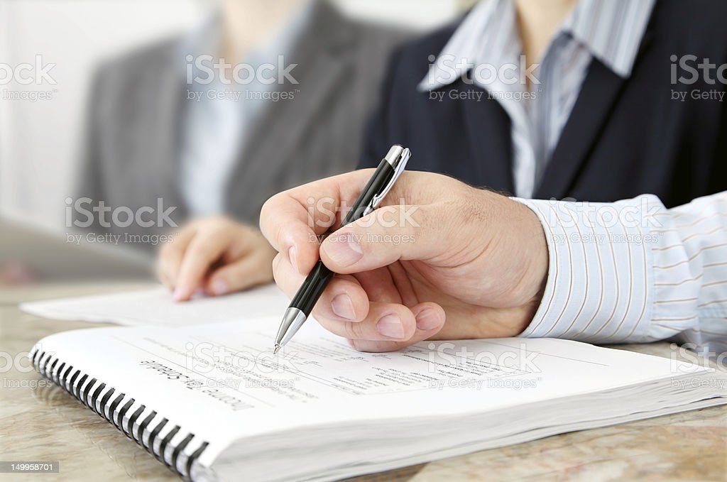 Male Hand with Pen at the Meeting royalty-free stock photo