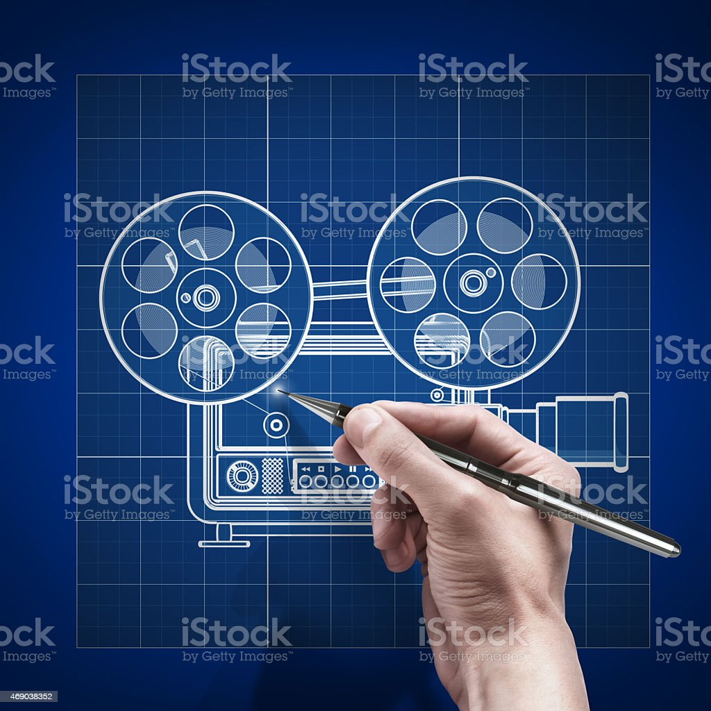 male hand with pen blueprint .concept old-fashioned cinema projector. stock photo