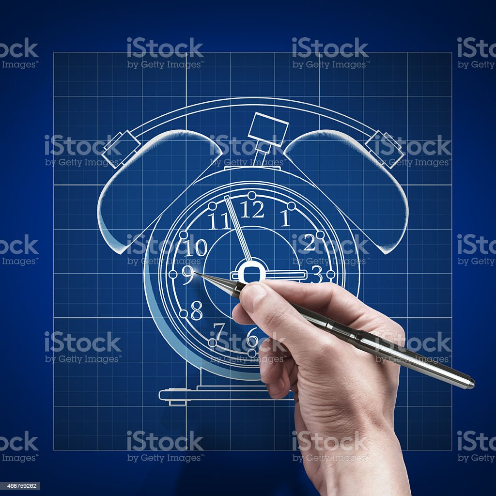 male hand with pen blueprint .Old-fashioned alarm clock. stock photo